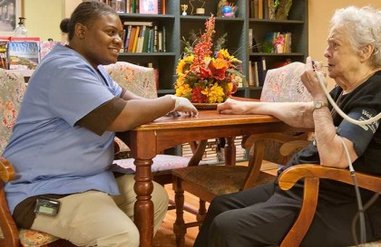 A nurse entretaining a olderly patient
