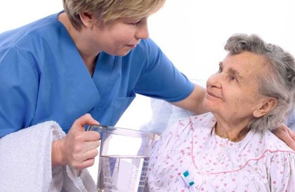 A nurse assisting a olderly patient
